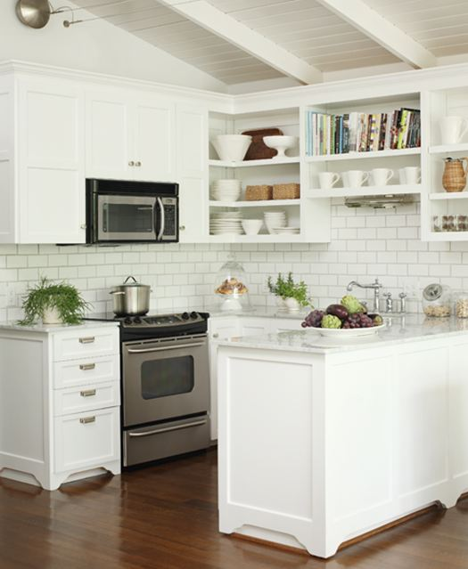 Small kitchen in a lake house with marble countertops, stainless steel appliances, open shelving, white cabinets and white subway tile backsplash