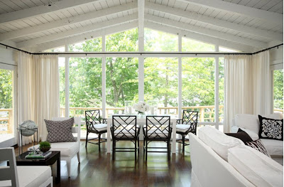 Living/Dining room with floor to ceiling picture windows, A-frame structure, white and brown furniture with an amazing view of Lake Hamilton
