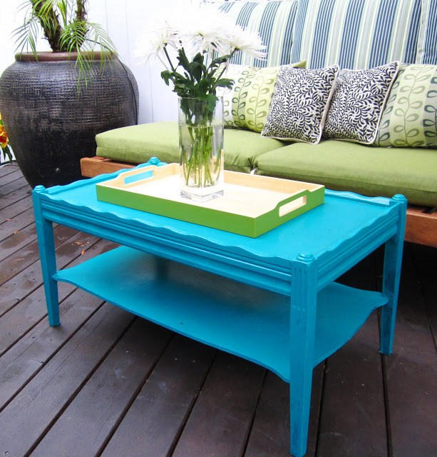 Outdoor deck with bright blue coffee table and lime green tray