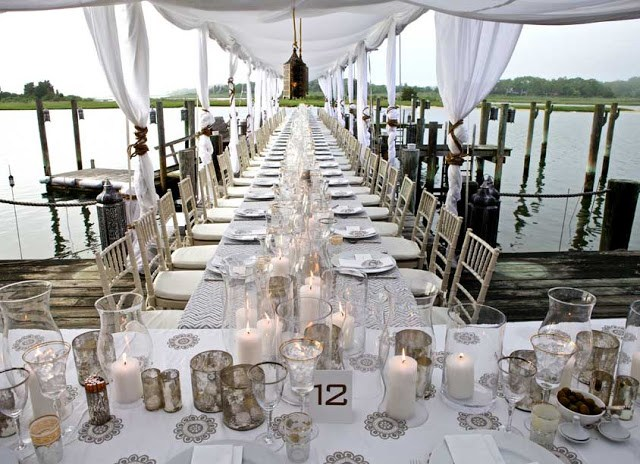 Elegant birthday table setting on a dock