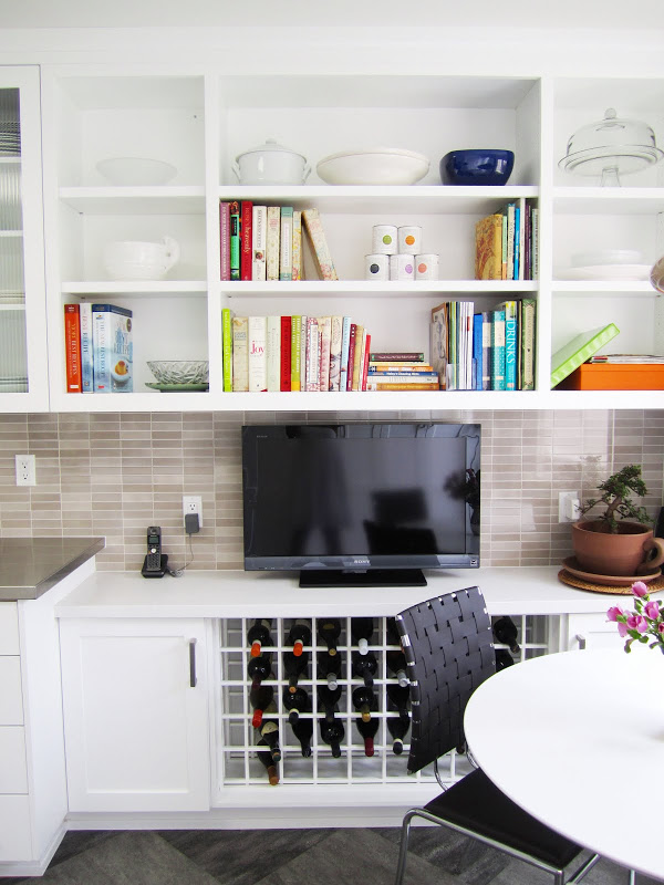 Breakfast nook with bookshelves for cook books, under counter wine rack and a TV