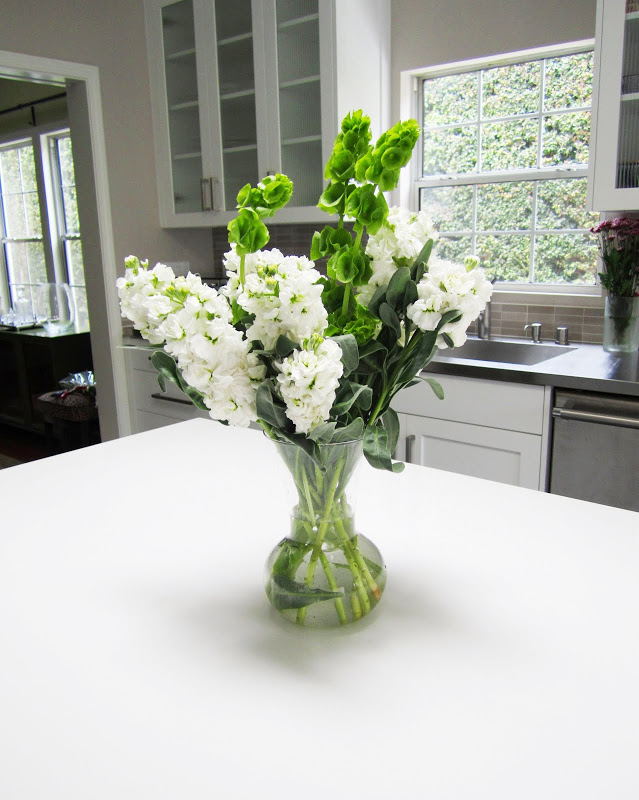 Flower arrangement on a white kitchen island
