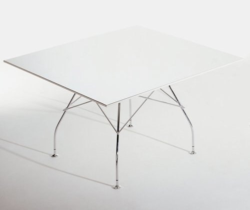 White glossy dining table with chrome legs from y living