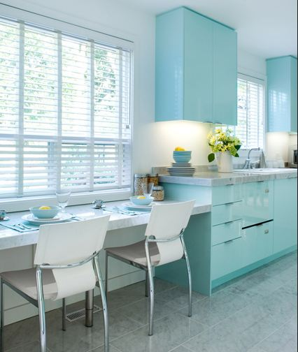 Bright, modern and airy kitchen with pale blue glossy cabinets and a grey tile floor