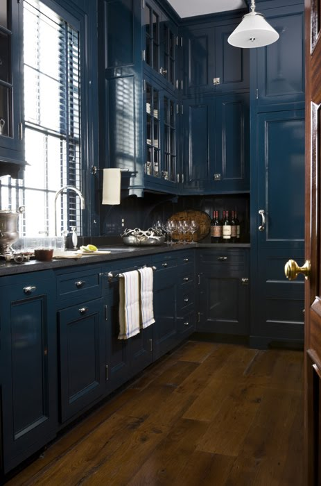 Traditional kitchen with dark blue cabinets and a wood floor