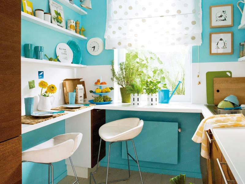 Small turquoise kitchen with floating shelves, wood cabinets and painted bar