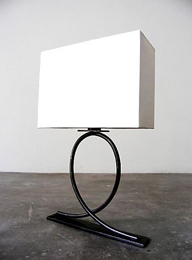 Iron based loop table lamp with white linen shade