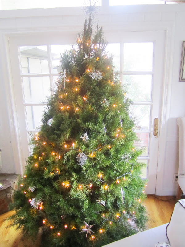 Christmas tree in a living room leaning to the right