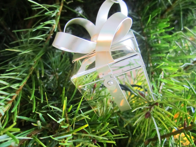 Close up of a present Christmas ornament in a Christmas tree