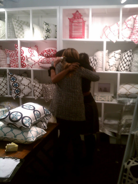 group hug in the COCOCOZY booth at the New York International Gift Fair