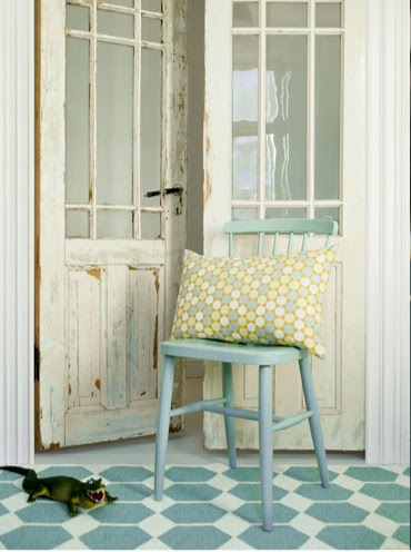Brita Sweden rug in a foyer with a rustic door and powder blue wooden chair