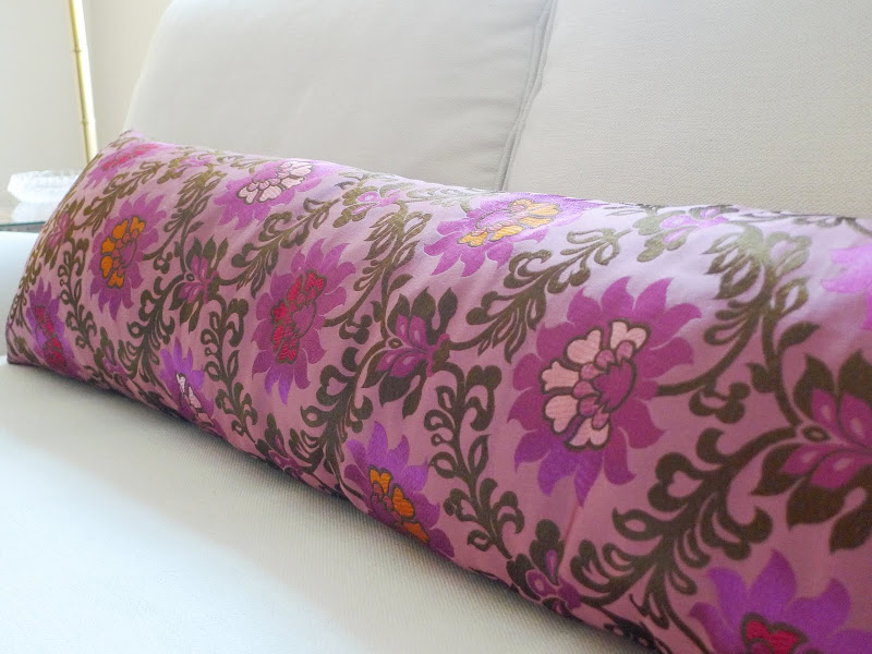 Close up of the long pink pillow and the gorgeous flower pattern on it