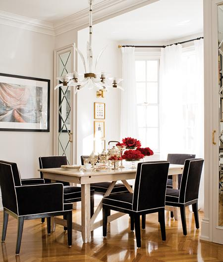 Dining room with balck upholstered dining chair with white piping