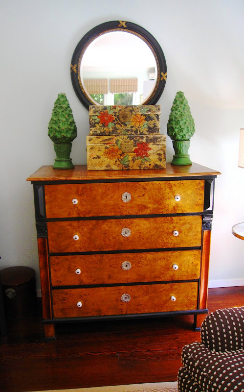 Antique wood dresser in a sea foam living