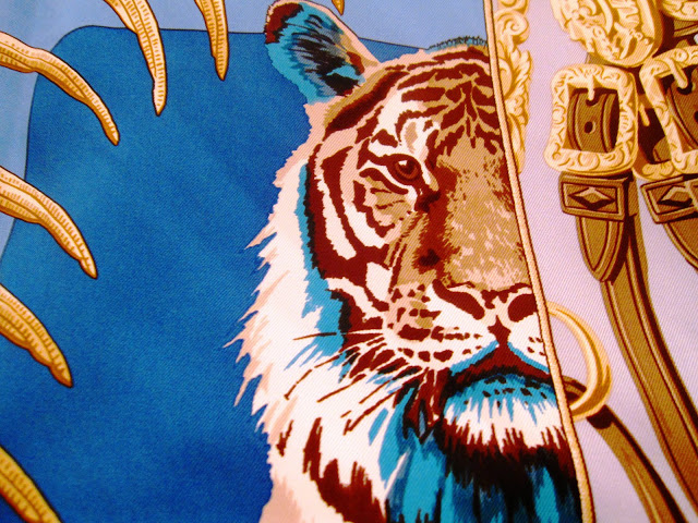 Close up of the tiger on the Hermes' Carre en Carres scarf