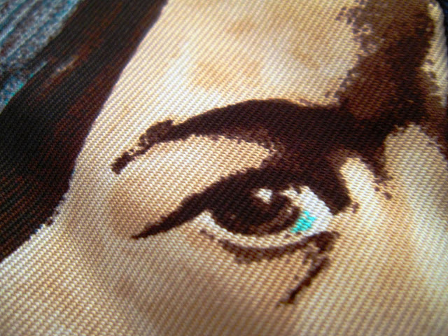 Close up of the detail on a native american man on the Hermes Carre en Carres scarf