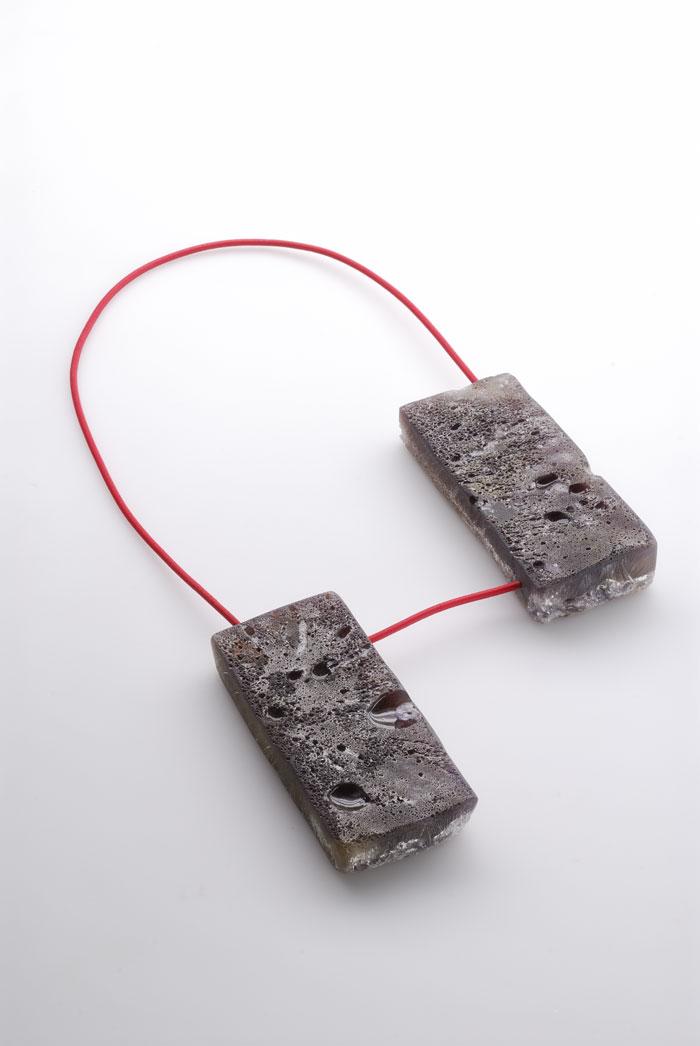 "Coco Dunmire - ""Moon Rock"" (2008). Necklace. Resin, pigment, elastic."