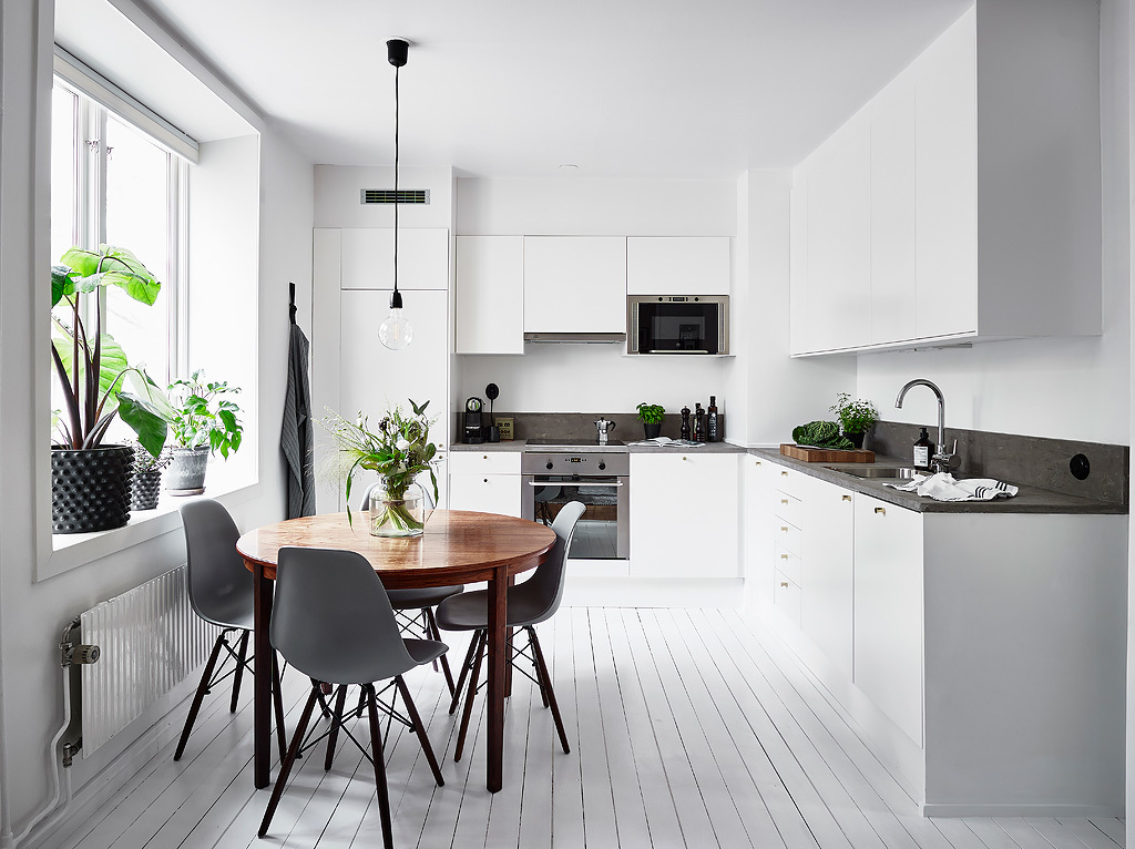White Kitchen With A Round Dining Table