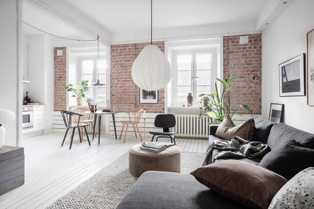 Small and cozy home with an exposed brick wall
