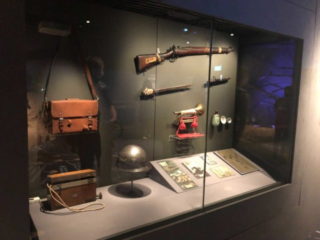 Items owned by the Japanese, including a portable radio, propaganda materials, and a rifle.