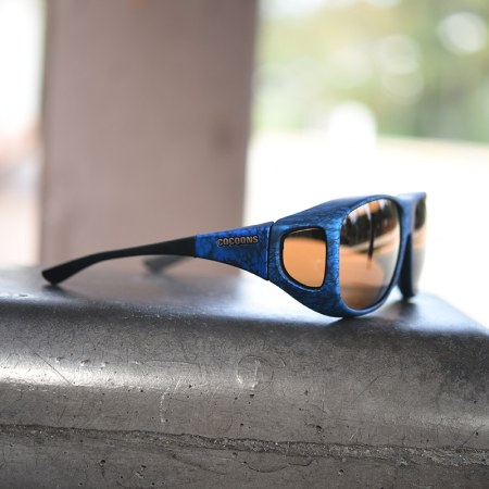 Ink and cement cocoons fitover sunglasses