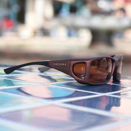 Burgundy fitover sunglasses with a copper lens system
