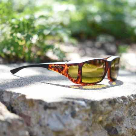 Tortoiseshell Cocoons fitover sunglasses featuring yellow lenses