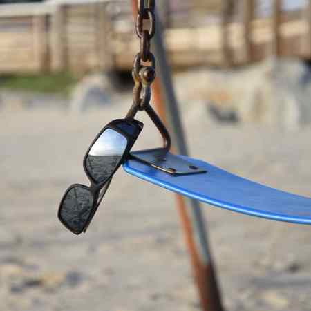 Silver mirror fitover sunglasses on swing