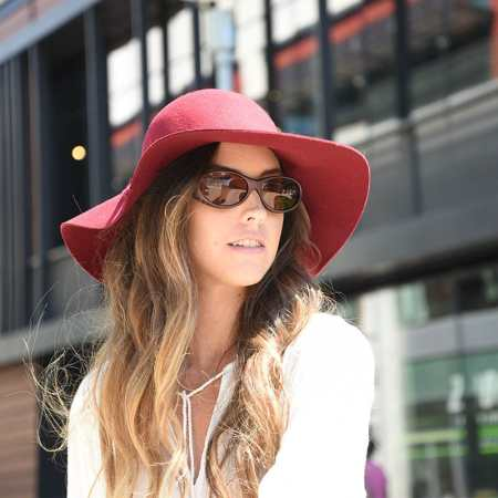 big red hat over burgundy cocoons fitover sunglasses