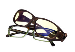 Cocoons Mini Slim fitovers have a compact rectangle frame shape designed to fit smaller, rectangular eyewear frames and feature an HEV blue light filter system