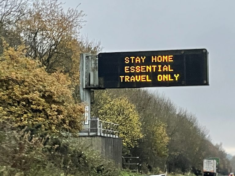 Matrix sign displaying Stay Home Essential Travel Only