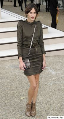 British model Alexa Chung poses for photographers as she arrives for the Burberry Prorsum Spring/Summer 2011 fashion show at the London Fashion Week