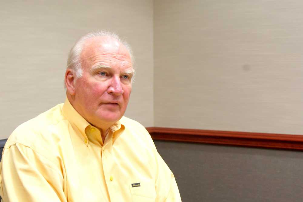 President Robert Breuder, as pictured above during an August 2014 interview with The Courier, is set to retire in March 2016.