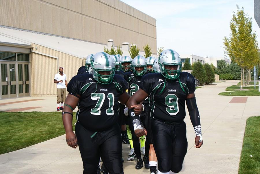 The Chaparrals exit the PE Center to head for the football field.