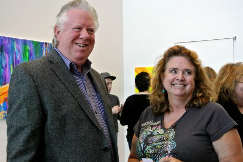 Mike Hunnicut and Jennifer Harith standing side-by-side as student and teacher in the Wings Gallery at the College of DuPage on Dec. 3rd, 2014.