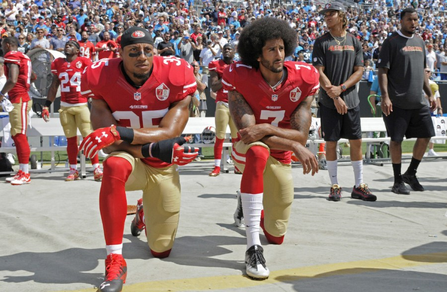 San+Francisco+49ers%27+Colin+Kaepernick+%287%29+and+Eric+Reid+%2835%29+kneel+during+the+national+anthem+before+an+NFL+football+game+against+the+Carolina+Panthers+in+Charlotte%2C+N.C.%2C+Sunday%2C+Sept.+18%2C+2016.+%28AP+Photo%2FMike+McCarn%29