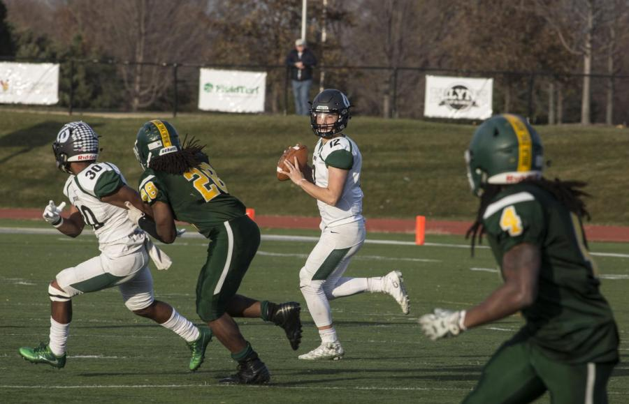 Quarterback+Asher+O%27Hara+led+the+Chaps+to+victory+during+the+2017+Red+Grange+Bowl