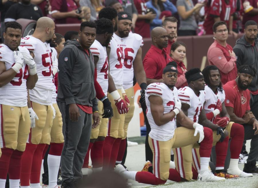 NFL+players+kneel+in+protest+of+police+brutality+during+National+Anthem%2C+stirring+a+partisan+debate