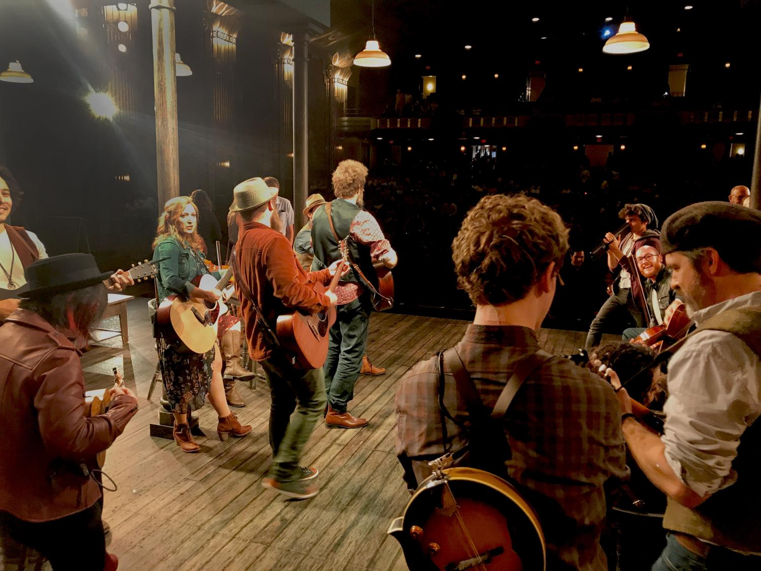 Photo by Jennifer Kurz: The Cast of Paramount's 'Once' performs on stage as patrons are served at the stage bar