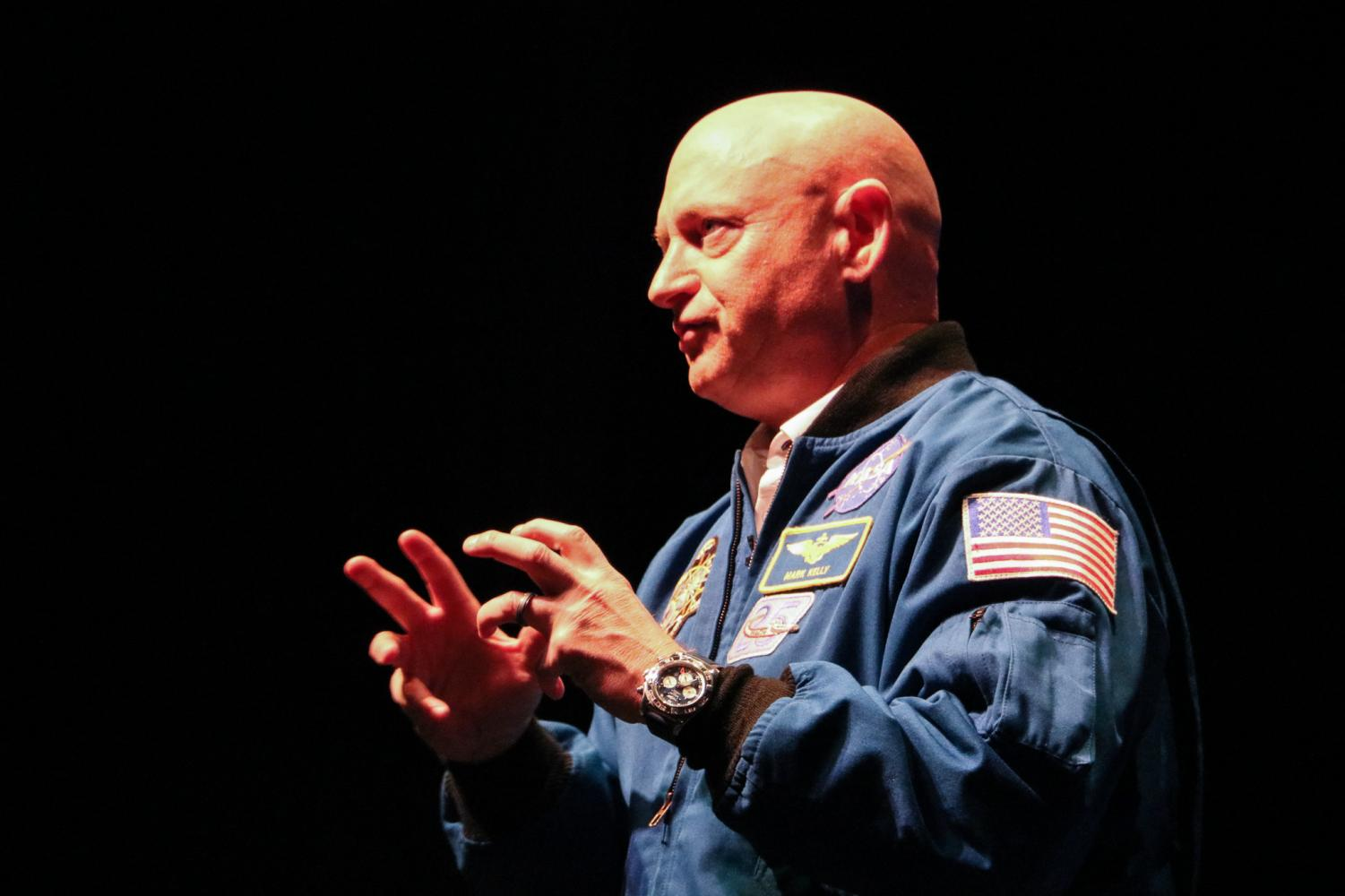 Former astronaut Mark Kelly speaks at the College of DuPage, bringing audience members on a voyage, explaining how the lessons he's learned throughout his life have shaped the leader he has become