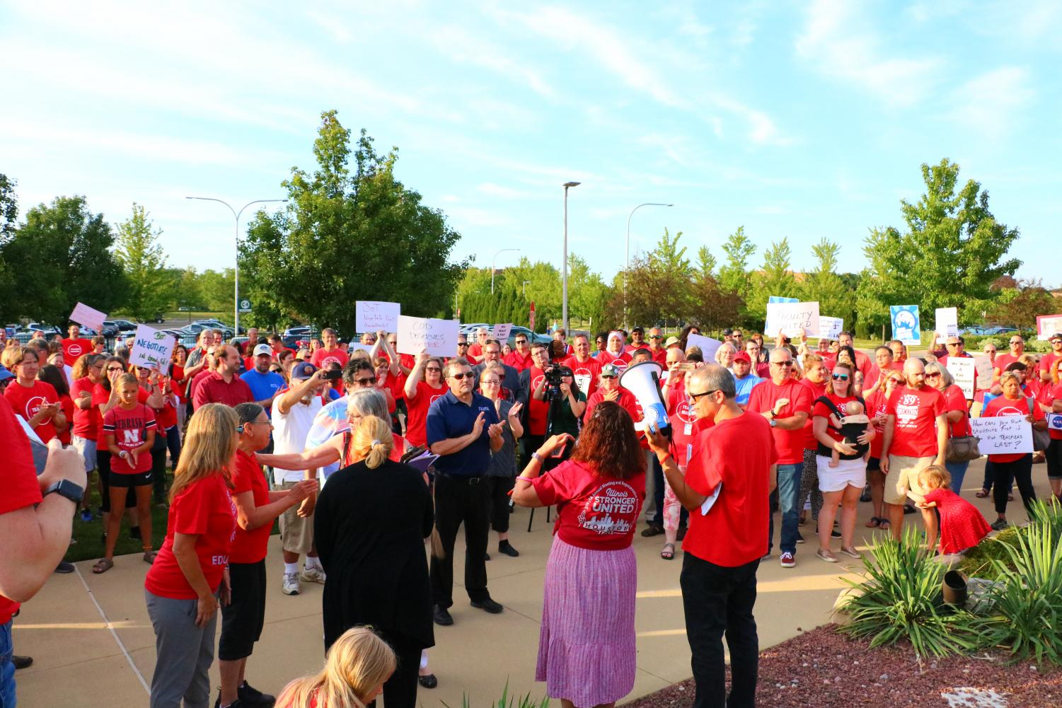 Teachers and community supporters protest outside of College of DuPage calling for more pay and increased benefits in the new full-time Faculty contract (photo by Alison Pfaff)