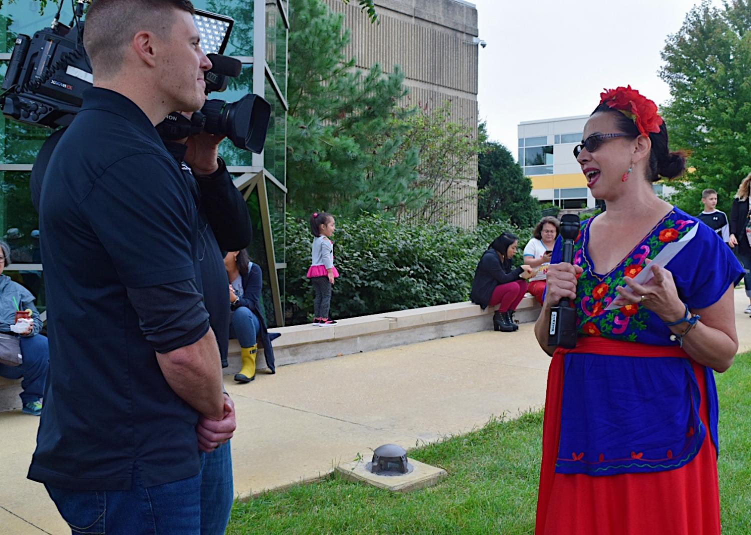 An+attendee%2C+who+is+dressed+to+represent+Frida+Kahlo%2C+being+interviewed.