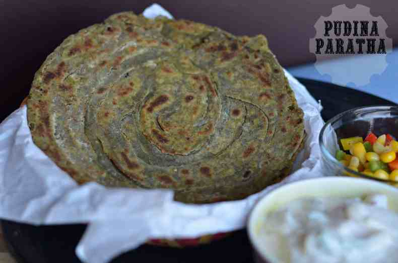 Pudina laccha paratha, as the name suggest this paratha or flat bread is made using whole wheat flour and mint leaves. Having mint in the paratha makes it so flavorful and aromatic. Also, it is a laccha paratha (layered flatbread), which is another addition of crisp and crunchy texture. Pudina laccha paratha is great choice for any time meal with either chutney or curry or raita.