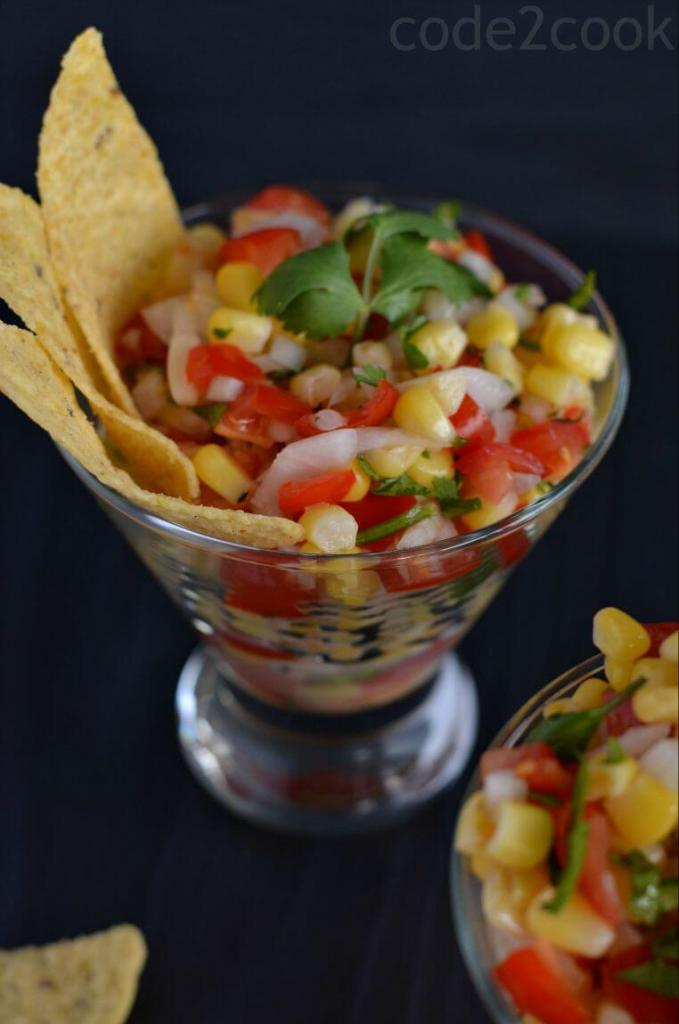 This corn salsa is quite easy to make, combining sweet corn, chopped tomato, onion, serrano chili, cilantro and a dash of lime juice. This is a perfect recipe for nachos or addson in a burrito bowl. Even it is a kind of salad which will go perfectly for snack time or with your rice recipes.