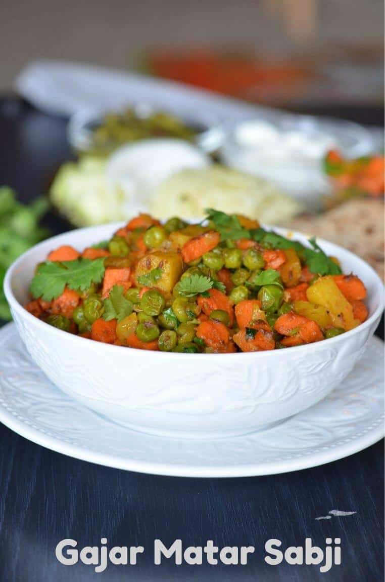 Gajar Matar sabji is a dry mix of carrots and peas sauteed in oil with spices. A very simple dish to use all seasonal veggies and create a flavorful dish. This gajar matar ki sabji is cooked mostly in winters because that's when fresh carrots and peas are available in the market.