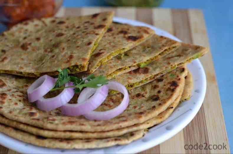 Peas paratha or Matar ka paratha is a delicious Indian flatbread, where whole wheat soft dough ball is stuffed with mashed green peas. This paratha is easy, healthy, and very nutritious. Peas paratha taste great if peas stuffing is little spicy as peas have little sweet taste. Peas paratha is the perfect dish for breakfast or in any meal accompanied with raita and pickle.