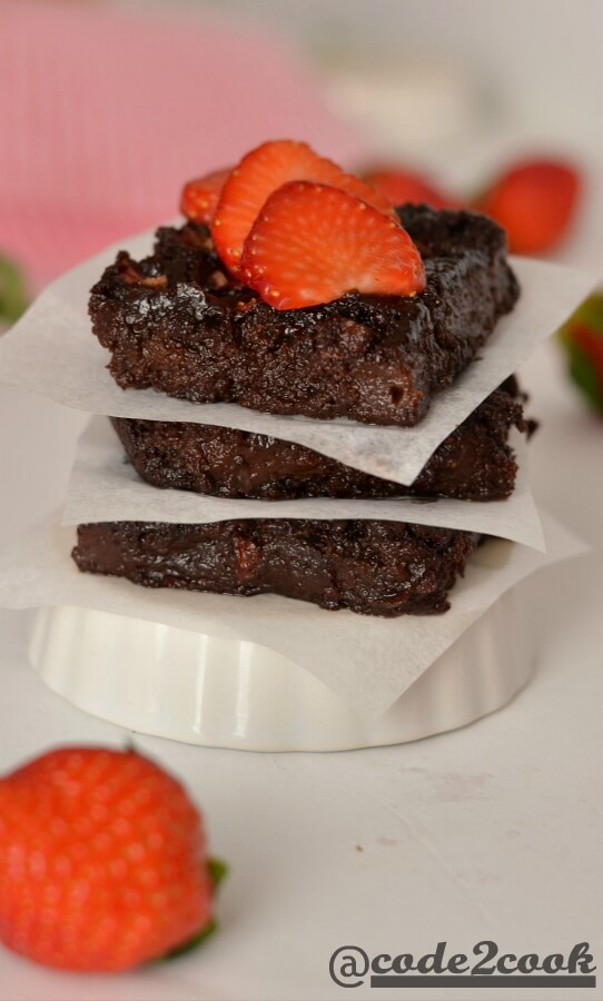 Eggless strawberry brownie is a sweet, tangy, and chocolate flavored fudge brownie for Valentine's day but can be made on any occasion. Basically, it is kind of chocolate covered strawberries in fudgy brownie form. Eggless Strawberry brownie is easy to make brownie recipe with healthy ingredients and fresh strawberries. It is best served with vanilla ice cream or whipped cream or just sliced strawberries.
