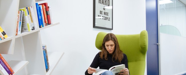Employee reading book at work
