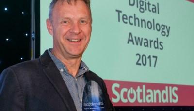 Harvey accepting ScotlandIS award