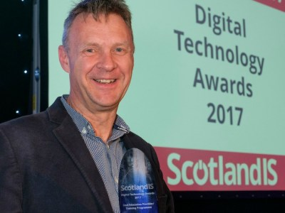 Harvey accepting ScotlandIS award